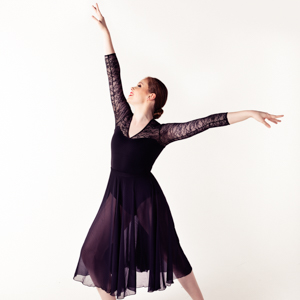 Dancer Amelia in a dance pose, arm outstretched above.