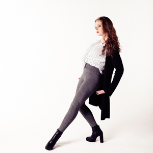 Musical Theatre performer Amelia in a leaning back dance pose.