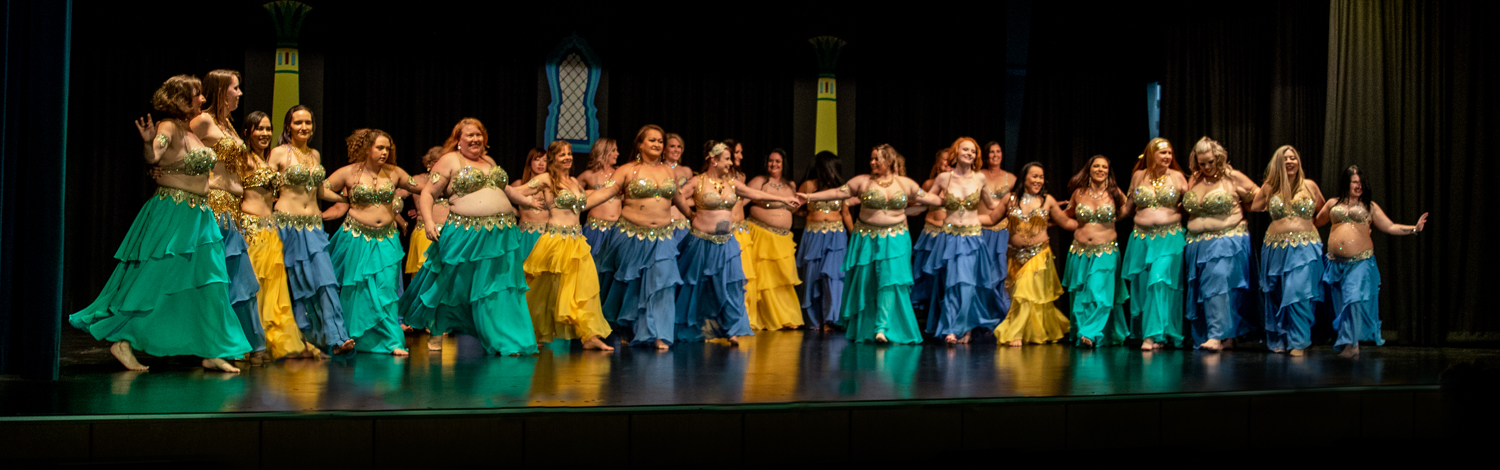 Bellydancers line up onstage in clsoing bars of 30 dancers for 30 years performance